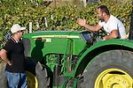 ALBANIA, Berat , farmer Agim Metka and son Engiell with new John Deere Tractor  / ALBANIEN, Berat, Landwirt Agim Metka, sein Sohn Engiell mit neuem John Deere Traktor im Gespreach mit JD Distributor