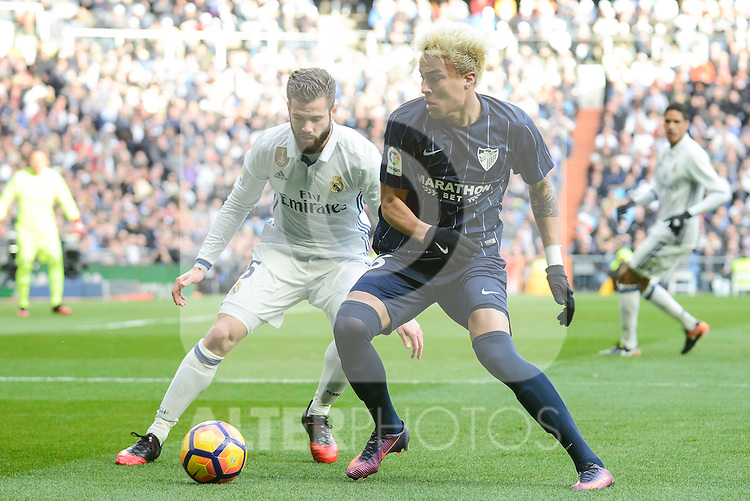 Real Madrid's Nacho Fernandez and Malaga CF's Adalberto Peñaranda Maestre during La Liga match between Real Madrid and Malaga CF at Santiago Bernabeu Stadium in Madrid, Spain. January 21, 2017. (ALTERPHOTOS/BorjaB.Hojas)
