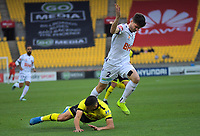 Perth's Alex Grant fouls Phoenix's Jaushua Sotirio during the A-League football match between Wellington Phoenix and Perth Glory at Westpac Stadium in Wellington, New Zealand on Sunday, 27 October 2019. Photo: Dave Lintott / lintottphoto.co.nz