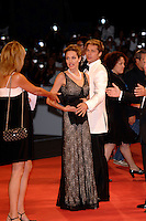 ANGELINA JOLIE &amp; BRAD PITT<br /> Premiere of &quot;The Assassination of Jesse James by the Coward Robert Ford&quot; at the 64th Venice Film Festival (La Biennale di Venezia), Venice, Italy.<br /> September 2nd, 2007<br /> full length long black lace layered dress pearl necklace couple cream white tuxedo jacket suit funny face   <br /> Ref: CAP/PL<br /> &copy;Phil Loftus/Capital Pictures /MediaPunch ***NORTH AND SOUTH AMERICAS ONLY***