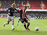 Lee Evans of Sheffield Utd and George Saville of Millwall  during the championship match at the Bramall Lane Stadium, Sheffield. Picture date 14th April 2018. Picture credit should read: Simon Bellis/Sportimage