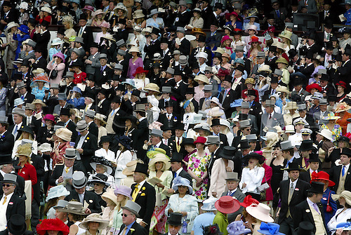 Ascot crowd in front of the Royal Enclosure. Ladies Day, Royal Ascot 030619 Photo: Neil Tingle/Action Plus...2003 horse racing fashion hat hats woman glamour  dress dresses