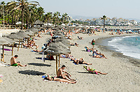Beach, sun worshippers, bathers, swimmers, near Puerto Banus, Marbella, Malaga Province, Spain, Espana, October, 2017, 20171010154716<br /><br />Copyright Image from Victor Patterson, 54 Dorchester Park, <br />Belfast, UK, BT9 6RJ<br /><br />t1: +44 28 9066 1296 (from Rep of Ireland 048 9066 1296)<br />t2: +44 28 9002 2446 (from Rep of Ireland 048 9002 2446)<br />m: +44 7802 353836<br /><br />victorpatterson@me.com<br />www.victorpatterson.com<br /><br />Please see my Terms and Conditions of Use at VICTORPATTERSON.COM. It is IMPORTANT that you familiarise yourself with them.<br /><br />Images used on the Internet must be visibly watermarked i.e. &copy;VICTORPATTERSON.COM within the body of the image and copyright metadata must not be deleted. Images used on the Internet have a size restriction of 4kbs and are chargeable at the then current NUJ rates.<br /><br />This image is only available for the use of the download recipient i.e. television station, newspaper, magazine, book publisher, etc, and must not be passed on to any third party. It is also downloaded on condition that each and every usage is notified within 7 days to victorpatterson@me.com<br /><br />The right of Victor Patterson to be identified as the author is asserted in accordance with The Copyright Designs And Patents Act (1988).