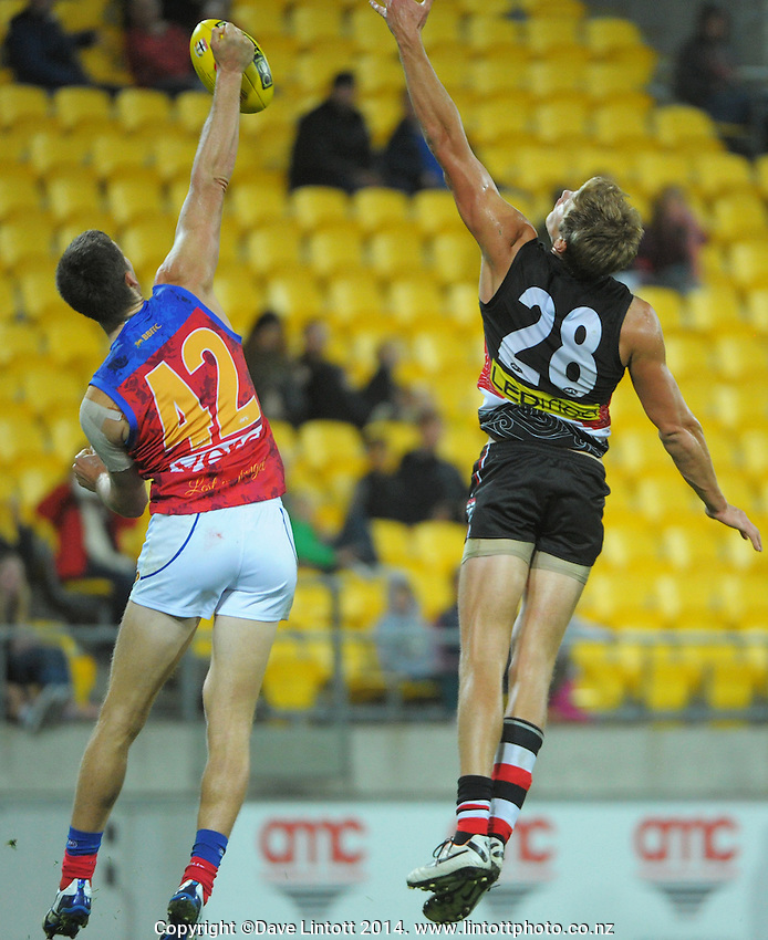 Justin Clarke beats Rhys Stanley to the ball during the ANZAC Day AFL match between St Kilda Saints and Brisbane Lions at Westpac Stadium, Wellington, New Zealand on Friday, 25 April 2014. Photo: Dave Lintott / lintottphoto.co.nz