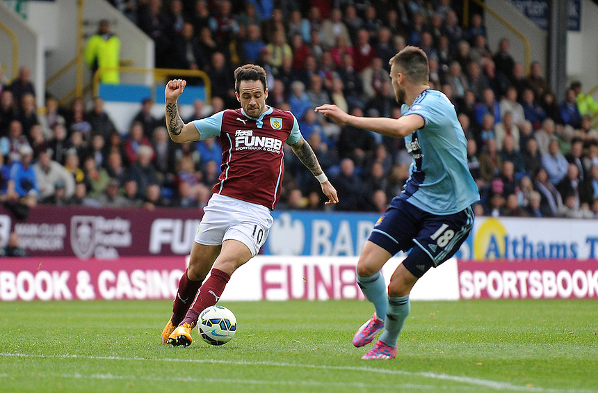 Burnley's Danny Ings in action during todays match  <br /> <br /> Photographer Ian Cook/CameraSport<br /> <br /> Football - Barclays Premiership - Burnley v West Ham United - Saturday 18th October 2014 - Turf Moore - Burnley<br /> <br /> &copy; CameraSport - 43 Linden Ave. Countesthorpe. Leicester. England. LE8 5PG - Tel: +44 (0) 116 277 4147 - admin@camerasport.com - www.camerasport.com