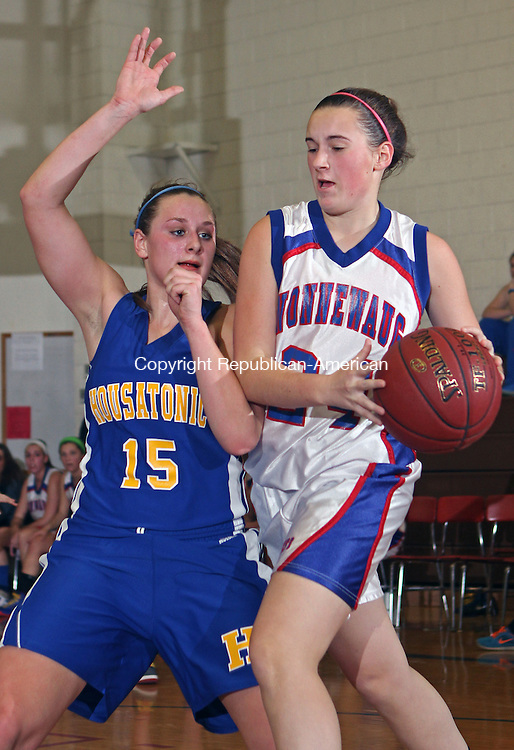 Woodbury, CT12112MK02 Nonnewaug's Allyson Charette (24) drives against Housatonic's Katie Heacox during Berkshire League action Friday night at Nonnewaug High School in Woodbury. Nonnewaug defeated Housatonic 65-49. Michael Kabelka / Republican-American