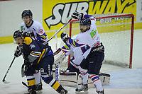IJSHOCKEY: HEERENVEEN: THIALF: 16-01-2013, Friesland Flyers - Tilburg Trappers, Eindstand 1-3, Mark Hoekstra (#52) en Trevor Hunt (#24) verdedigen de goal van de Flyers, ©foto Martin de Jong