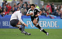 New Zealand hooker Ash Dixon runs at Welsh second row Josh Turnbull during the Division A semi-final at Ravenhill. Result New Zealand 36 Wales 12.