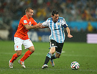 Lionel Messi of Argentina holds off the challenge of Jordy Clasie of Netherlands