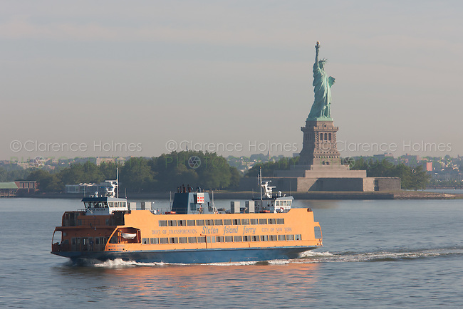 Staten Island Ferry Alice Austen passes the Statue of Liberty in route from Manhattan to Staten Island.