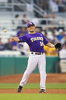LSU Tigers third baseman Christian Ibarra #14 makes a throw to first base against the Auburn Tigers in the NCAA baseball game on March 23, 2013 at Alex Box Stadium in Baton Rouge, Louisiana. LSU defeated Auburn 5-1. (Andrew Woolley/Four Seam Images).