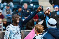 Lawrence Olum (13) of Sporting Kansas City celebrates scoring with teammates  during the second half against the Philadelphia Union. Sporting Kansas City defeated the Philadelphia Union 2-1 during a Major League Soccer (MLS) match at PPL Park in Chester, PA, on October 26, 2013.
