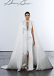 Model walks runway in a high neck beaded deep v bridal gown with high slit and beaded cape, from the Dennis Basso for Kleinfeld 2018 Bridal Collection on October 5 2017, during New York Bridal Fashion Week.
