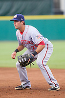 Hagerstown Suns first baseman Carlos Lopez (26) on defense against the Greensboro Grasshoppers at NewBridge Bank Park on June 21, 2014 in Greensboro, North Carolina.  The Grasshoppers defeated the Suns 8-4. (Brian Westerholt/Four Seam Images)
