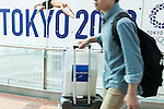 A traveller walks past a Tokyo Olympic and Paralympic Games advertisement on display at Haneda-Airport Domestic Terminal 1 on August 30, 2016, Tokyo, Japan. Between August 24 and October 10 the airport is displaying many Welcome to Tokyo 2020 signs to promote the 2020 Summer Olympic Games. (Photo by Rodrigo Reyes Marin/AFLO)