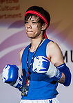Umeo Mei (Blue) of Japan enters to the ring prior the female muay 51KG division weight bout against Au Yin Yin Winnie (Not in picture) of Hong Kong during the East Asian Muaythai Championships 2017 at the Queen Elizabeth Stadium on 13 August 2017, in Hong Kong, China. Photo by Yu Chun Christopher Wong / Power Sport Images