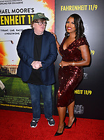 LOS ANGELES, CA. September 19, 2018: Michael Moore &amp; Omarosa Manigault Newman at the Los Angeles premiere for Michael Moore's &quot;Fahrenheit 11/9&quot; at the Samuel Goldwyn Theatre.<br /> Picture: Paul Smith/Featureflash