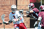 Orange, CA 05/01/10 - Andrew Clayton (Chapman # 3) and Nick Roessler (LMU # 31) in action during the LMU-Chapman MCLA SLC semi-final game in Wilson Field at Chapman University.  Chapman advanced to the final by defeating LMU 19-10.
