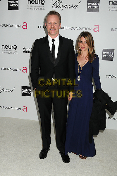 Morgan Spurlock & Alexandra Jamieson.20th Annual Elton John Academy Awards Viewing Party held at West Hollywood Park, West Hollywood, California, USA..February 26th, 2012.full length suit blue dress married husband wife black white goatee facial hair tie .CAP/ADM/BP.©Byron Purvis/AdMedia/Capital Pictures.