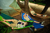 Sleeping in hammocks has become a popular choice for boys attending Boy Scout resident camp at Camp Raven Knob in summer 2010. Camp Raven Knob Scout Reservation, one of the largest Boy Scout camps in the United States, is located within Boy Scouts of America's Old Hickory Council in Mt. Airy, North Carolina. Troops from across the US attend the camp's one-week residential boys' summer programs, which offer instruction on more than 40 merit badges, adventure programs and new Scout orientation.