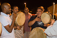 "Tripoli, Libya.  Muslim Wedding Celebrations.  Wedding  Musicians Play the ""Taddridja"" while escorting the groom to meet his new wife on their first night together."