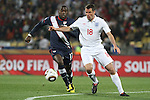 12 JUN 2010: Jamie Carragher (ENG) (18) and Jozy Altidore (USA) (17). The England National Team tied the United States National Team 1-1 at Royal Bafokeng Stadium in Rustenburg, South Africa in a 2010 FIFA World Cup Group C match.