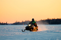 Snowmobile on Lake of the Woods<br /> Kenora<br /> Ontario<br /> Canada