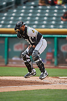 Jose Briceno (10) of the Salt Lake Bees blocks the throw against the  Albuquerque Isotopes during the game at Smith's Ballpark on April 8, 2018 in Salt Lake City, Utah. Albuquerque defeated Salt Lake 11-4. (Stephen Smith/Four Seam Images)