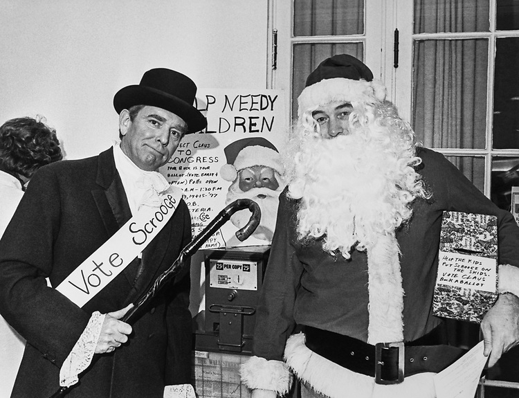 Staff member with Santa Claus at a Christmas event. (Photo by Keith Jewell/CQ Roll Call via Getty Images)