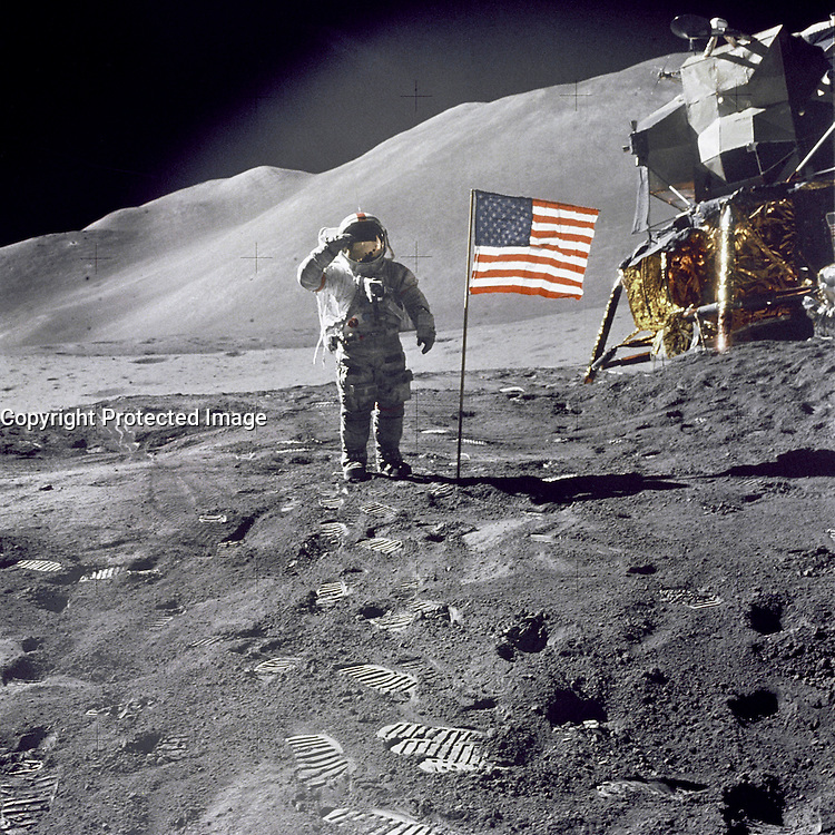 1971-07-26, File Photo - Apollo 15 Commander Dave Scott salutes the American flag at the the Hadley-Apennine lunar landing site. The Lunar Module &quot;Falcon&quot; is partially visible on the right.<br /> <br /> Apollo 15 was the ninth manned mission in the Apollo program and the fourth mission to land on the Moon. It was the first of what were termed &quot;J missions&quot;, long duration stays on the Moon with a greater focus on science than had been possible on previous missions. The mission began on July 26, 1971, and concluded on August 7th.<br /> <br /> Commander David Scott and Lunar Module Pilot James Irwin spent three days on the Moon and a total of 18&not;Ω hours outside the spacecraft on lunar extra-vehicular activity. <br /> <br /> Image Credit: NASA