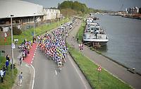 peloton riding next to the Schelde river<br /> <br /> 102nd Scheldeprijs 2014