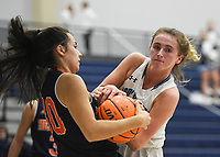 Har-Ber guard Caylan Koons (5) wrestles for position of the ball with Heritage Jazmine Perez (30), Friday, February 7, 2020 during a basketball game at Wildcat Arena at Har-Ber High School in Springdale. Check out nwaonline.com/prepbball/ for today's photo gallery.<br /> (NWA Democrat-Gazette/Charlie Kaijo)