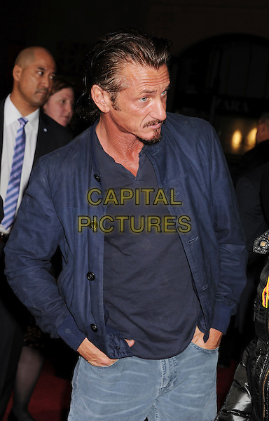 "Sean Penn.arriving at the Los Angeles Premiere of ""Gangster Squad"" at Grauman's Chinese Theatre in Hollywood, California on January 7th 2013.   .half length blue jacket jeans tanned hands in pockets looking down .CAP/ROT/TM.©Tony Michaels/Roth Stock/Capital Pictures"