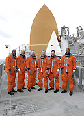 Cape Canaveral, FL - November 3, 2009 -- On Launch Pad 39A at the National Aeronautics and Space Administration's (NASA) Kennedy Space Center in Florida, the STS-129 crew, dressed in their launch-and-entry suits, appear ready for liftoff following the completion of their Terminal Countdown Demonstration Test, a dress rehearsal for launch on November 3, 2009. Behind them are space shuttle Atlantis' external tank and the nose cone of a solid rocket booster. From left are Mission Specialists Leland Melvin and Randy Bresnik; Pilot Barry E. Wilmore; Commander Charles O. Hobaugh; and Mission Specialists Mike Foreman and Robert L. Satcher Jr. Additional training associated with the test was done in October, but the simulated countdown was postponed because of a scheduling conflict with the launch of NASA's Ares I-X test rocket. Launch of Atlantis on its STS-129 mission to the International Space Station is set for November 16, 2009. On STS-129, the crew will deliver to the station two spare gyroscopes, two nitrogen tank assemblies, two pump modules, an ammonia tank assembly and a spare latching end effector for the station's robotic arm. .Mandatory Credit: Kim Shiflett - NASA via CNP