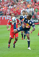 August 21 2010 New York Red Bulls forward Thierry Henry #14 displays some ball skills with his foot as Toronto FC midfielder Nick LaBrocca #21 looks on during a game between the New York Red Bulls and Toronto FC at BMO Field in Toronto..The New York Red Bulls won 4-1.