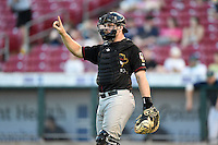 Quad Cities River Bandits catcher Brett Booth (9) signals one out during a game against the Cedar Rapids Kernels on August 18, 2014 at Perfect Game Field at Veterans Memorial Stadium in Cedar Rapids, Iowa.  Cedar Rapids defeated Quad Cities 5-3.  (Mike Janes/Four Seam Images)