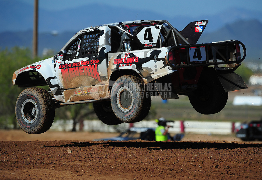 Apr 16, 2011; Surprise, AZ USA; LOORRS driver Ron Duncombe (4) during round 3 at Speedworld Off Road Park. Mandatory Credit: Mark J. Rebilas-.