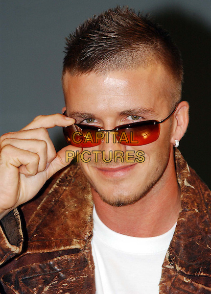 "DAVID BECKHAM.At Launch Of New Range Of Sunglasses by ""Police"".sunglasses, shades, headshot, portrait, piercing, earrings, straring over glasses, stubble, facial hair.www.capitalpictures.com.sales@capitalpictures.com.© Capital Pictures"