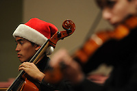 NWA Media/ J.T. Wampler - Thor O'Conner performs while wearing a festive hat Monday Dec. 8, 2014 during the Bentonville High School Chamber Orchestra's Winter Christmas concert at the Bella Vista Community Church. Donations are being sought to help support the orchestra with its trip to Orlando, Fla., for the national competition at the Festival of Gold next year.