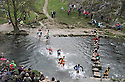 04/11/12 ..Some of the leading runners make their way across the river...The majority of runners make their way through freezing water next to the stepping stones crossing on the river dove near Ashbourne, Derbyshire as they race in today's Dovedale Dash which saw nearly 1,500 runners tackle the arduous 4? mile cross country course in The Peak District..All Rights Reserved - F Stop Press.  www.fstoppress.com. Tel: +44 (0)1335 300098.