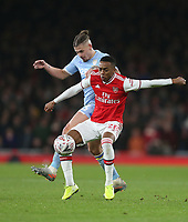 Arsenal's Joe Willock and Leeds United's Kalvin Phillips<br /> <br /> Photographer Rob Newell/CameraSport<br /> <br /> Emirates FA Cup Third Round - Arsenal v Leeds United - Monday 6th January 2020 - The Emirates Stadium - London<br />  <br /> World Copyright © 2020 CameraSport. All rights reserved. 43 Linden Ave. Countesthorpe. Leicester. England. LE8 5PG - Tel: +44 (0) 116 277 4147 - admin@camerasport.com - www.camerasport.com