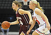Julia Rawlinson #14 of Mepham, left, gets pressured by Alyssa Accidino #20 of MacArthur during a Nassau varsity girls basketball game played at NYCB Live's Nassau Coliseum in Uniondale on Saturday, Dec. 23, 2017. Rawlinson recorded 18 points and 12 rebounds in Mepham's 45-40 win.