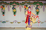 A woman in traditional garb performs a traditional Ryukyu dance inside the grounds of Shuri-jo Castle in Naha, Okinawa Prefecture, Japan, on June 24, 2012. Photographer: Robert Gilhooly