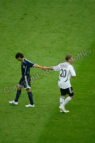 Jun 30, 2006; Berlin, GERMANY; Germany forward (20) Lukas Podolski and Argentina defender (2) Roberto Ayala shake hands during penalty shots after Ayala missed his shot on goal in quarterfinal action of the 2006 FIFA World Cup at Olympiastadion, Berlin. Podolski scored on his penalty shot and helped Germany defeat Argentina 4-2 on penalty shots following a 1-1 draw after extra time. Mandatory Credit: Ron Scheffler-US PRESSWIRE Copyright © Ron Scheffler