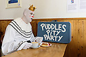 "Edinburgh, UK. 17.08.2016. Puddles Pity Party, the clown with the golden voice, sits, alone, in Circus Cafe, for ""a coffee, a pie, and a cry"". Puddle's new show, ""Let's Go"", is on at Assembly George Square, as part of the Edinburgh Festival Fringe. Photograph © Jane Hobson."