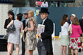 Racegoers wait for an Ascot train at Waterloo station on Ladies Day during Royal Ascot week.