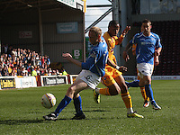 Steven Anderson beats Chris Humphrey in the Motherwell v St Johnstone Clydesdale Bank Scottish Premier League match played at Fir Park, Motherwell on 28.4.12.