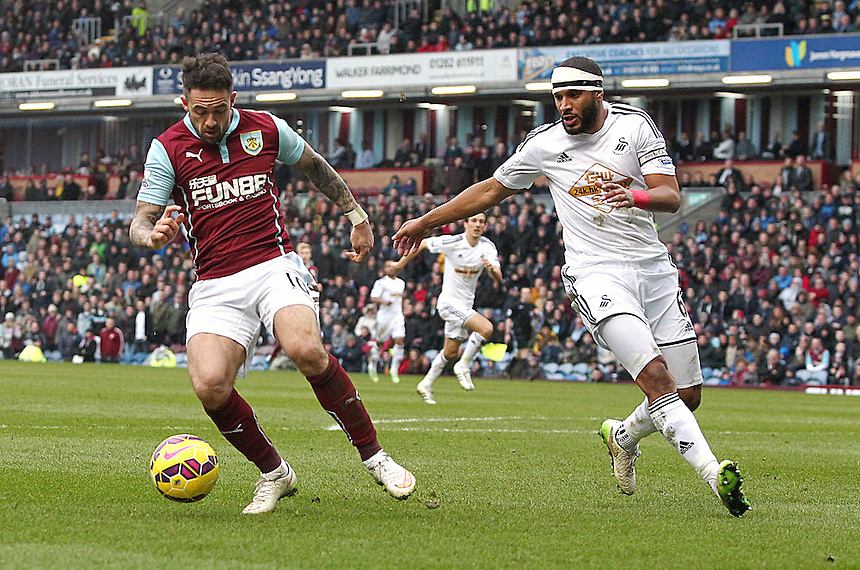 Burnley's Danny Ings under pressure from Swansea City's Ashley Williams<br /> <br /> Photographer Rich Linley/CameraSport<br /> <br /> Football - Barclays Premiership - Burnley v Swansea City - Friday 27th February 2015 - Turf Moor - Burnley<br /> <br /> &copy; CameraSport - 43 Linden Ave. Countesthorpe. Leicester. England. LE8 5PG - Tel: +44 (0) 116 277 4147 - admin@camerasport.com - www.camerasport.com