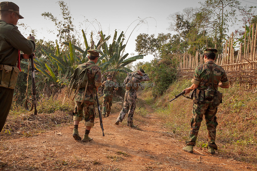 Soldiers with the Kachin Independence Army patrol near Burmese Army positions in Maija Yang, Myanmar, March 2012.