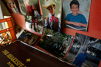 A collage of the past sits near developmentally disabled Amin Sadeghpour's favorite Shakespeare anthology in his apartment in Montebello, Calif., on Wednesday, April 4, 2007. (Photo by Bryce Yukio Adolphson/Brooks Institute of Photography, ©2007)